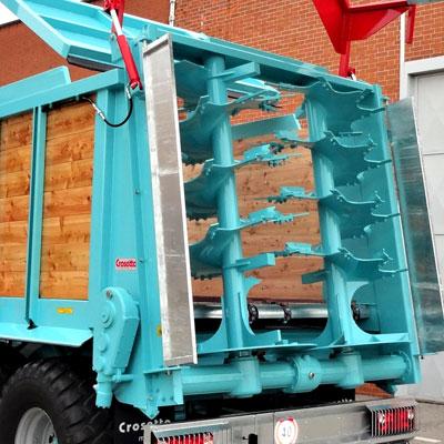 Système d'épandage à 2 hérissons et porte hydraulique